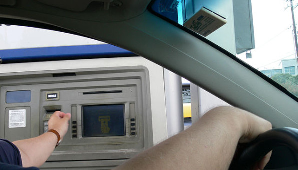 Drive-through ATM cashpoints can be found in most cities. Photo by Andreas Praefcke.